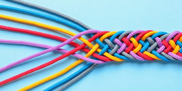 Braided ropes on color background, top view. Unity concept